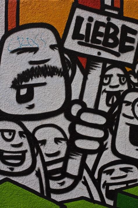 """One of Rebelzer's freaks holding """"Love"""" sign - Photo: Ingmar Sörgens"""