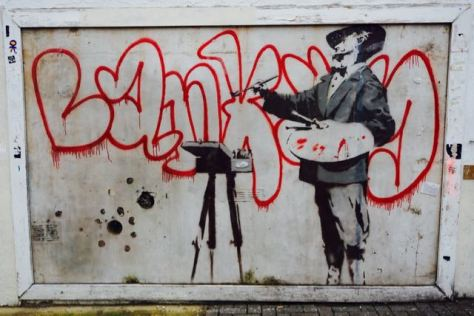 street art in london banksy graffiti painter portobello