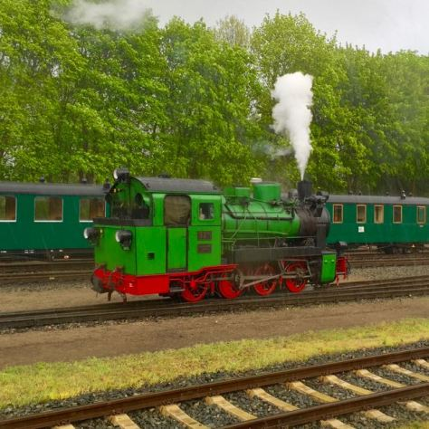 Things to do in Rügen Island in Baltic Sea in North East Germany - Rasender Roland Train Locomotive