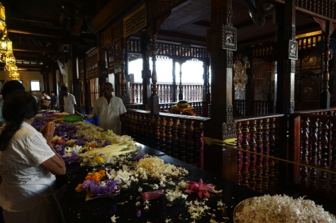 2 days in Kandy Central Province of Sri Lanka - Temple of the Sacred Tooth Relic - Sri Dalada Maligawa - Buddhist religious locals praying and making gifts of flowers